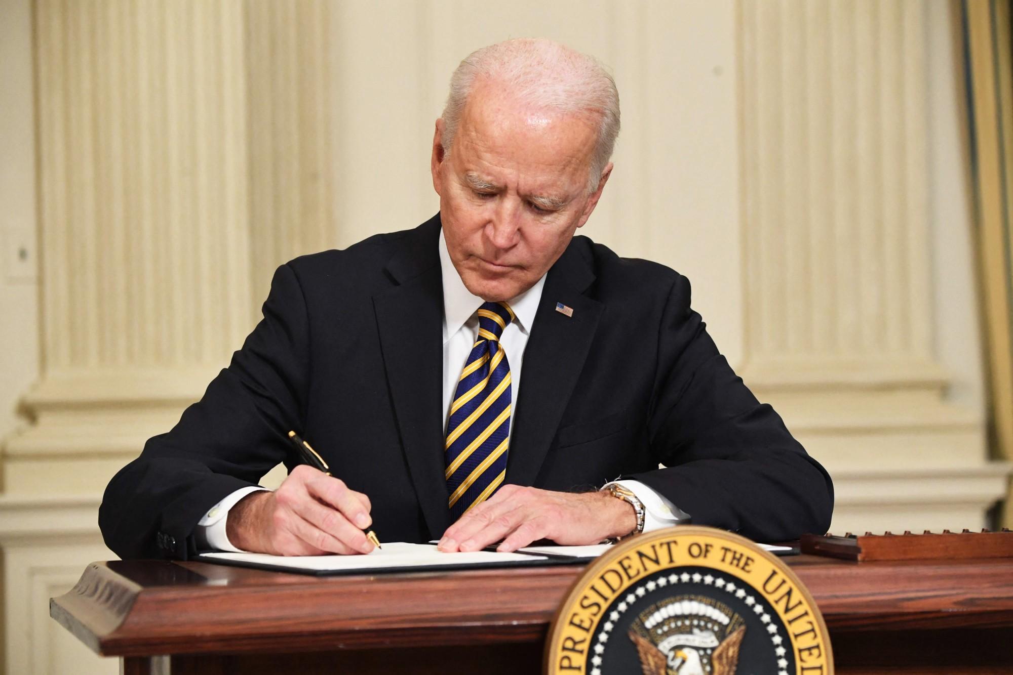 Pres. Joe Biden signs executive order on supply chains.
